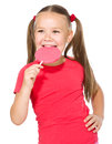 Little girl with lollipop happy big isolated over white Stock Photo