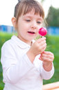 Little girl with lollipop happy outdoors Royalty Free Stock Image