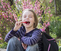 Little girl with lollipop happy outdoors in spring Stock Photography