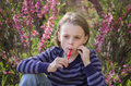 Little girl with lollipop happy outdoors in spring Stock Photo