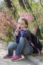 Little girl with lollipop happy outdoors in spring Royalty Free Stock Images