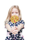 Little girl with lollipop isolated. Focus on candy Royalty Free Stock Photo
