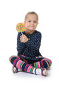 The little girl with lollipop on white background isolated Royalty Free Stock Image