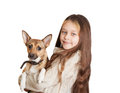 Little girl with long hair holding a dog on white background isolated Stock Photography