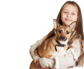 Little girl with long hair holding a dog on white background isolated Royalty Free Stock Photos