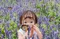 Little girl looking at butterfly with magnifying glass Royalty Free Stock Photo