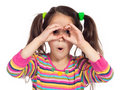 Little girl looking through imaginary binocular
