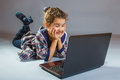 Little girl looking at laptop and smiling art Royalty Free Stock Photo