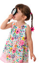Little girl looking through a magnifying glass Stock Photography