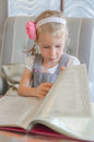 Little girl looking thru carte in lovely cafe Royalty Free Stock Photos