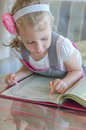Little girl looking thru carte in lovely cafe Royalty Free Stock Photo