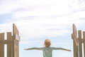 Little girl looks away in the background of the blue sky Royalty Free Stock Photo