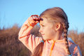 The little girl looks away portrait on nature Royalty Free Stock Image