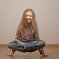 Little girl in lotus position is on hands beautiful cheerful Stock Photography