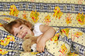 Little girl lying in bed Royalty Free Stock Images