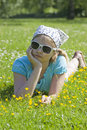 Little girl lying on grass Stock Photography