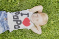 Little girl lying on the grass and dreaming Royalty Free Stock Photo