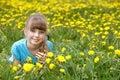 Little girl lying on grass in flower. Stock Photo