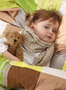 Little girl lying sick Stock Image