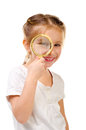 Little girl with magnifier isolated on a white background Royalty Free Stock Photos