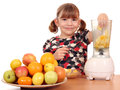 Little girl make fruit juice beautiful Stock Photo