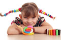 Little girl make snail Royalty Free Stock Photo