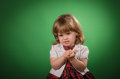 Little girl making faces portrait of against green background Stock Photography