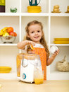 Little girl making fresh fruit juice Royalty Free Stock Image