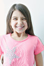 Little girl making a funny face emotions on the s smile white background Stock Photo