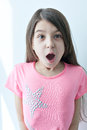 Little girl making a funny face expressions of surprise on the s white background Stock Images