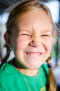 Little girl making funny faces Royalty Free Stock Photo