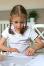 Little girl making paper plane. Royalty Free Stock Photo