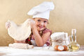 Little girl making pizza or pasta dough Stock Images