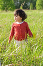 Little girl on meadow sunny day Stock Photo
