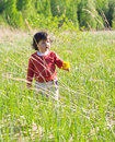 Little girl on meadow walking Stock Photo