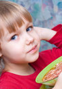 Little girl during a meal Stock Photos