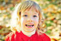 Little girl missing her first tooth in fall Royalty Free Stock Photography