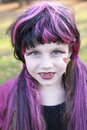 Little girl in monster girl costume a is dressed as a for halloween Royalty Free Stock Images