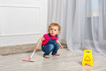 Little girl with mop Royalty Free Stock Photo