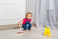 Little girl with a mop Royalty Free Stock Photo