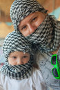 Little girl with mother in bedouin kerchief pretty Royalty Free Stock Photos