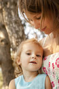 Little girl and mother in the park Stock Photography