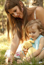 Little girl and mother in the park Royalty Free Stock Image