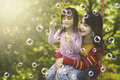 Little girl and mother plays with soap bubbles Royalty Free Stock Photo