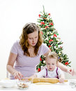 Little girl and mother are preparing cookies Royalty Free Stock Photos
