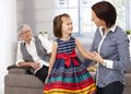 Little girl and mother talking adorable granny watching from behind Stock Image