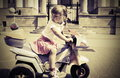 Little girl on a motorcycle Stock Photos