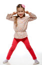 Little girl on the move cheerful positive naughty child jumping Stock Photo