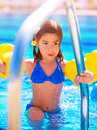 Little girl move out of the pool having fun in water summer vacation beach resort enjoying time in daycare active childhood Stock Images