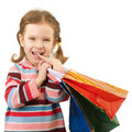 Little girl with multi-colored packages Royalty Free Stock Photography